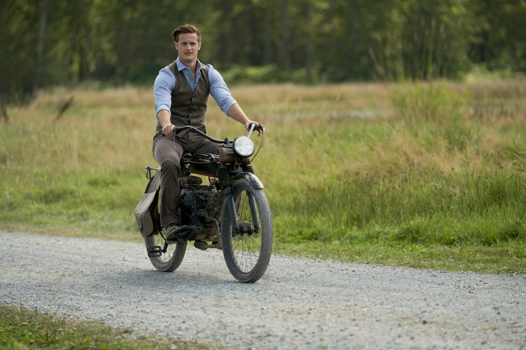 Jesse (Aren Buchholz) riding a motorcycle in When Calls the Heart