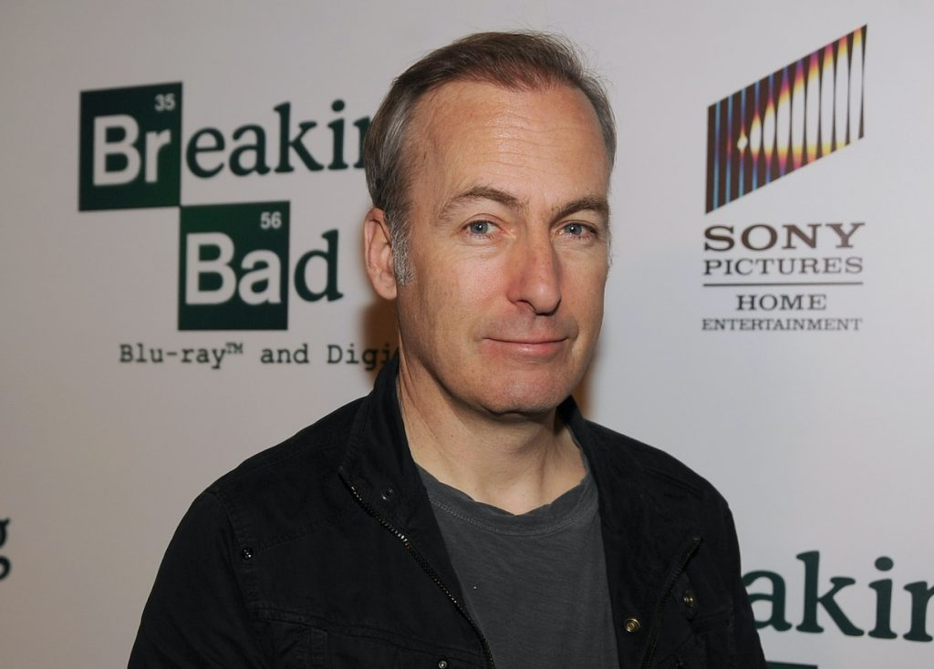 Bob Odenkirk at an event for 'Breaking Bad,' smirking at the camera