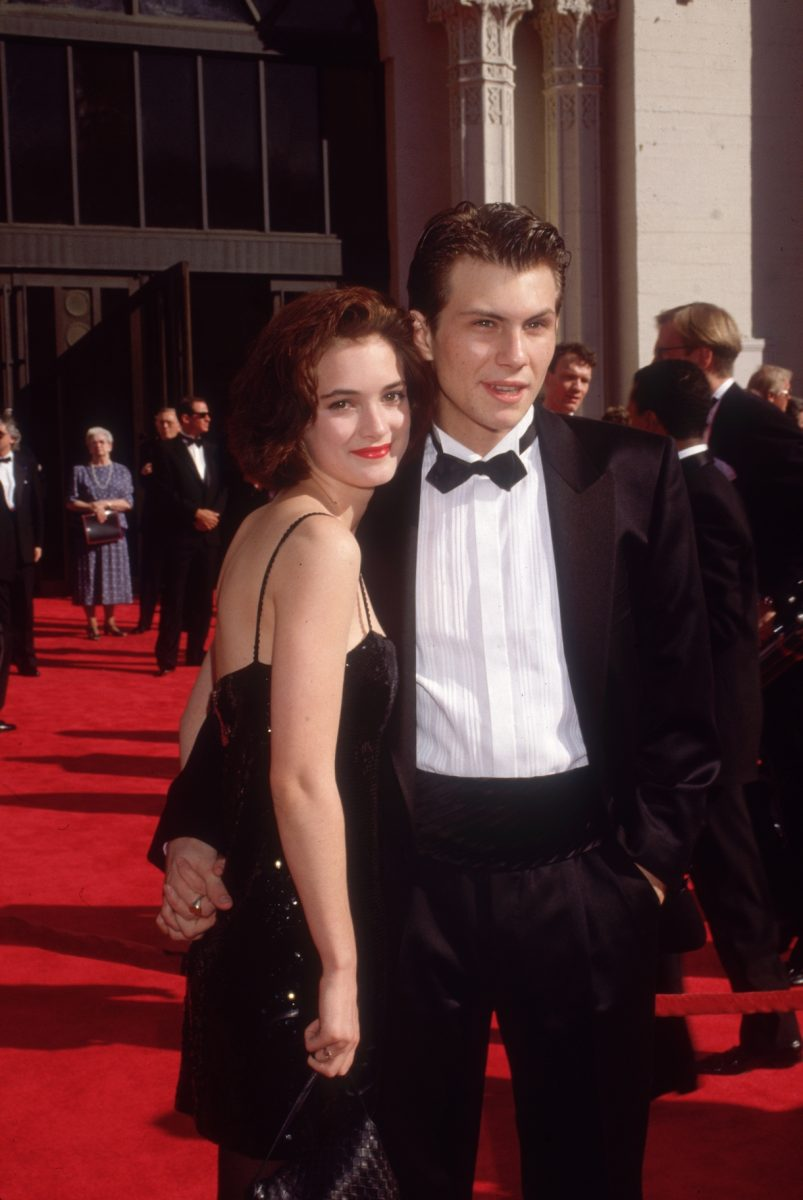 1989: American actors Christian Slater and Winona Ryder pose while holding hands on the red carpet, as they attend the Academy Awards