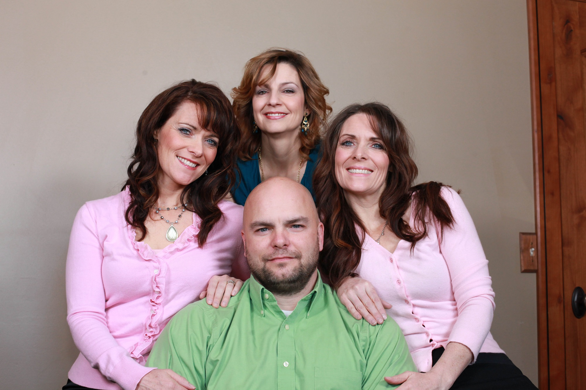 Joe Darger, 42, poses for a picture with his three wives Valerie, 41, Alina, 42 and Vicki, 41 on March 04, 2012
