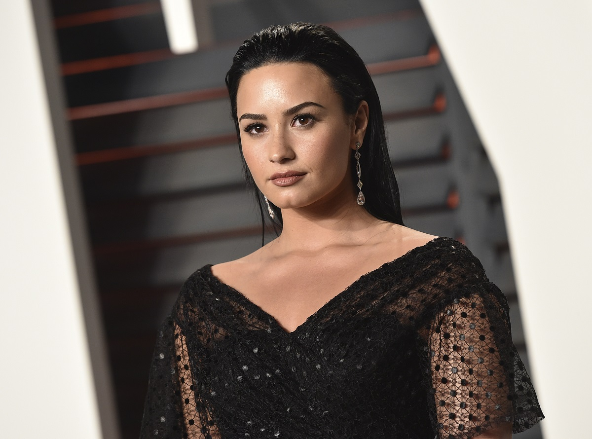 Demi Lovato dressed in black looking at the camera