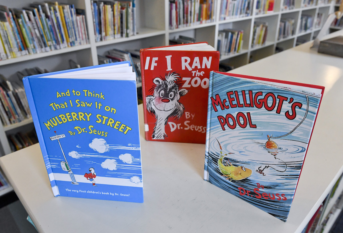 Copies of And to Think That I Saw It on Mulberry Street, If I Ran the Zoo, and McElligot's pool displayed on a table in a library