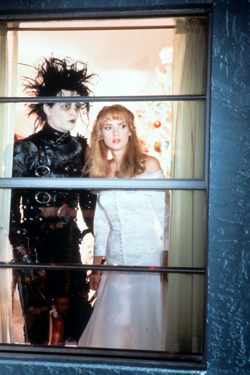 Johnny Depp and Winona Ryder looking out window in a scene from the film 'Edward Scissorhands', 1990
