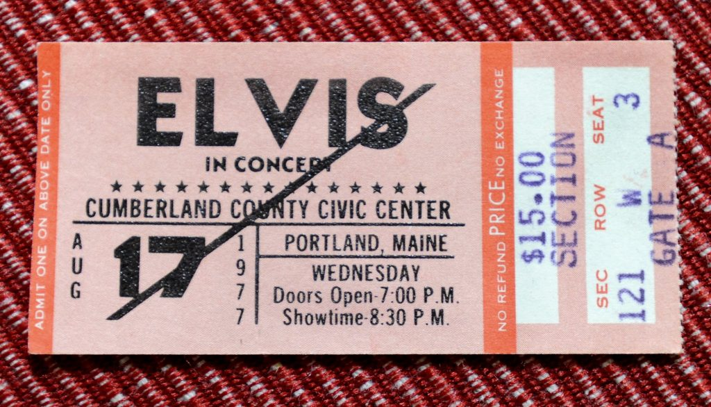A ticket to an Elvis Presley concert with a pen mark on it