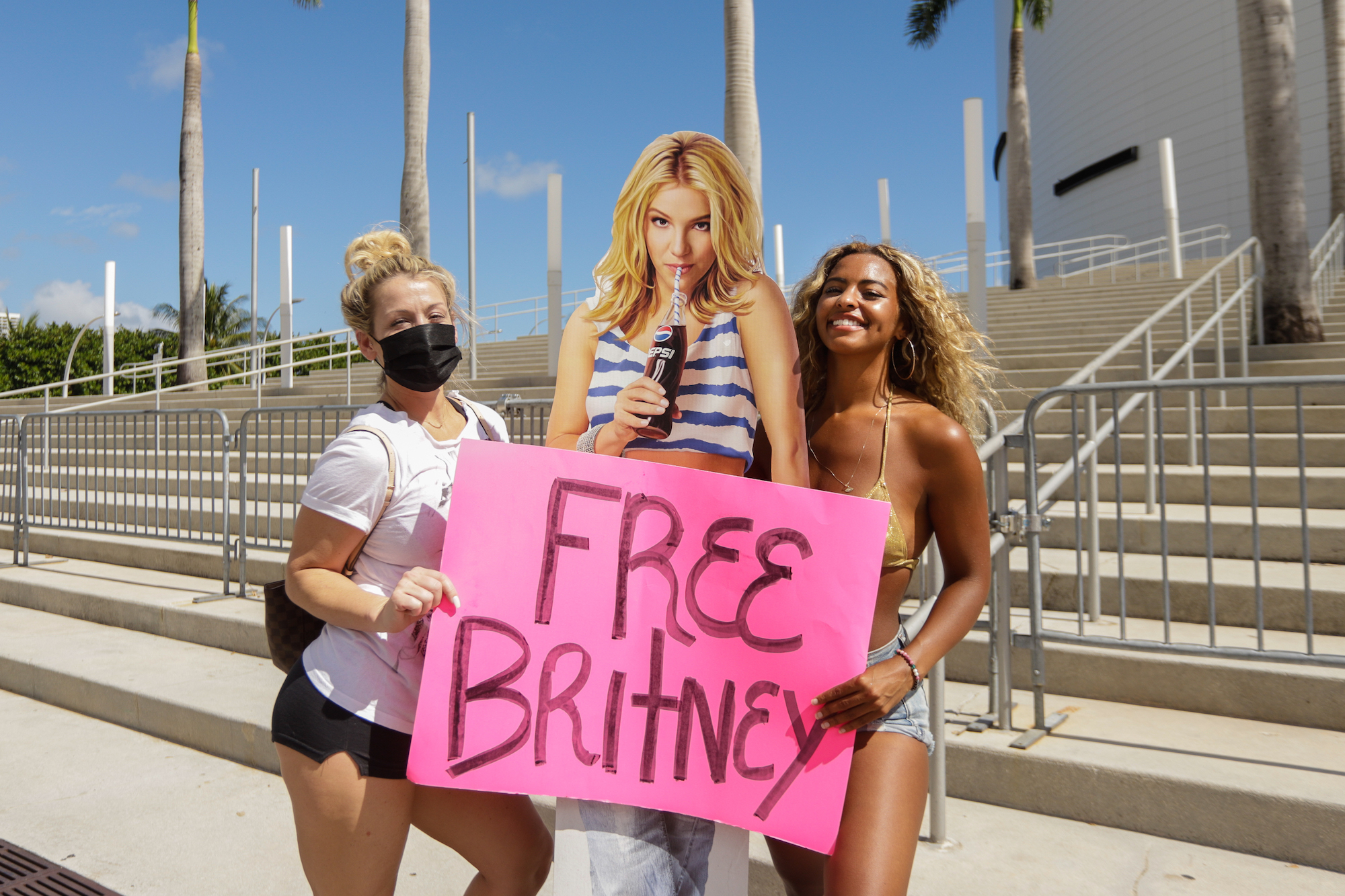 Supporters of Britney Spears holds a sign during a #FreeBritney protest on Feb. 11, 2021 in Miami, Florida