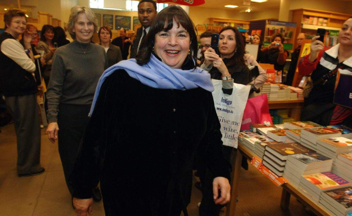 Barefoot Contessa Ina Garten smiles at a book signing with fans behind her