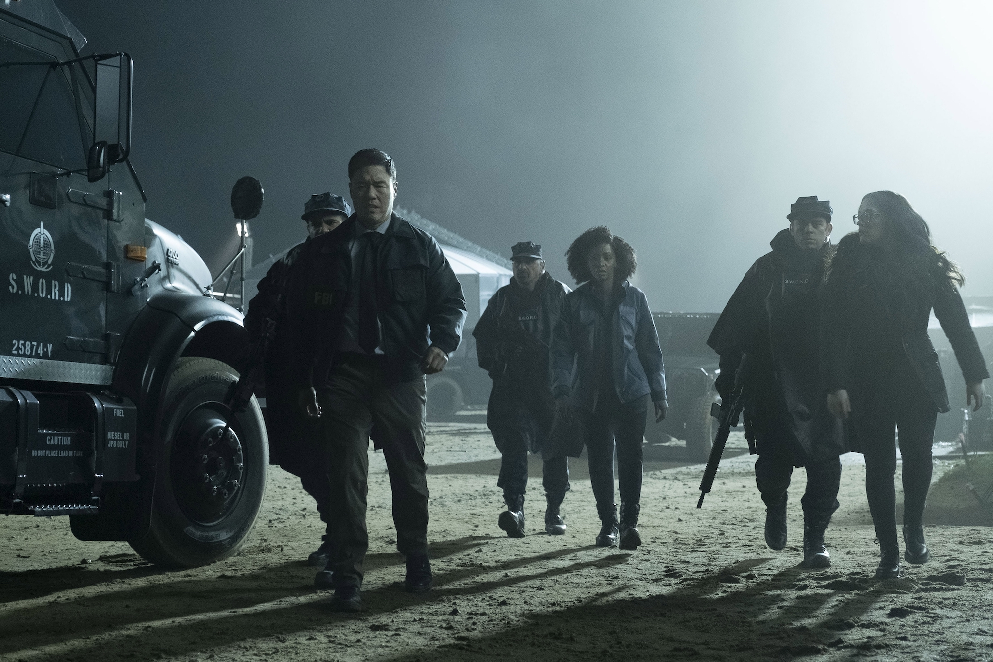 Jimmy Woo (Randall Park), Monica Rambeau (Teyonah Parris), and Darcy Lewis (Kat Dennings) are detained in 'WandaVision'
