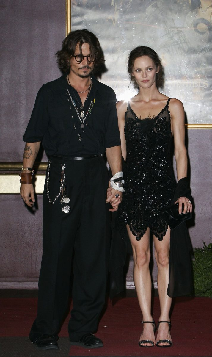 """Actor Johnny Depp and partner Vanessa Paradis attend the French premiere of """"Pirates of the Caribbean 2: Dead Man's Chest"""" in 2006"""