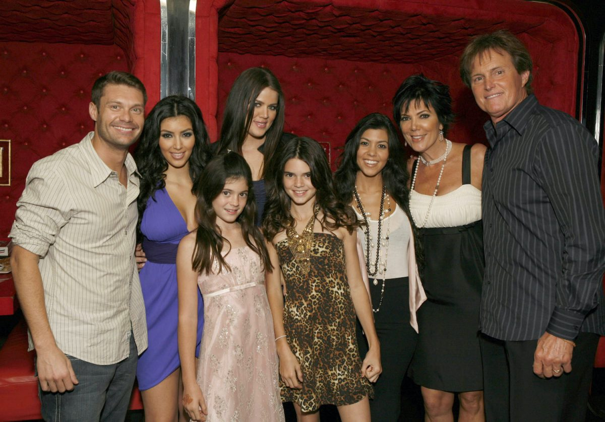 Ryan Seacrest, Kim Kardashian, Kylie Jenner, Khloe Kardashian, Kendall Jenner, Kourtney Kardashian, Kris Jenner, and Bruce Jenner pose for a photo at the 'Keeping Up With the Kardashians' viewing party