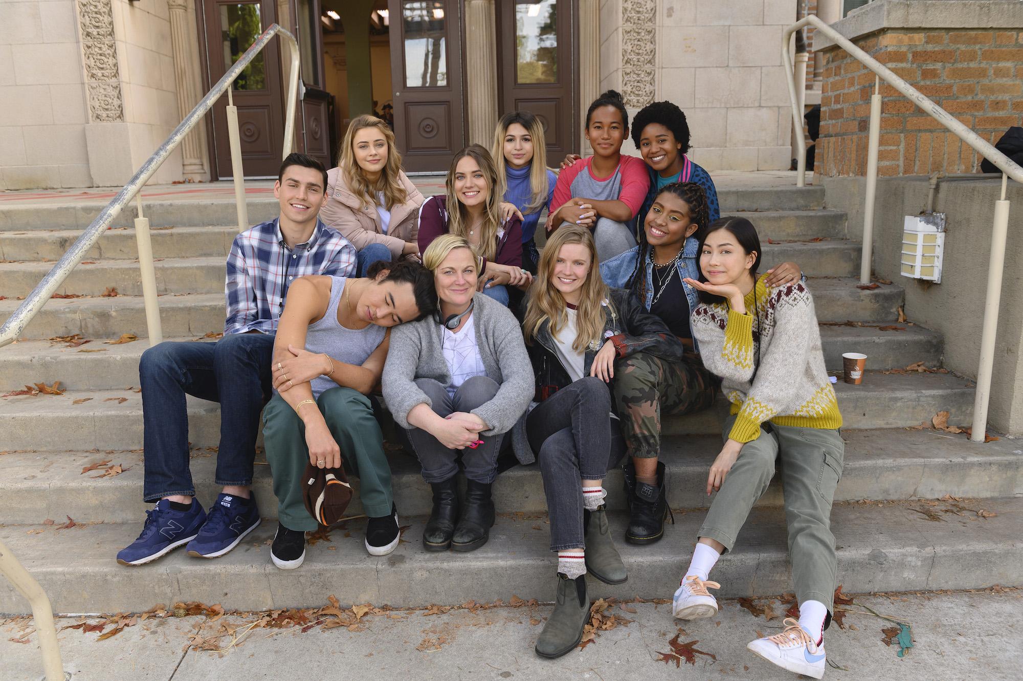 The cast of Netflix's 'Moxie' on set with Amy Poehler
