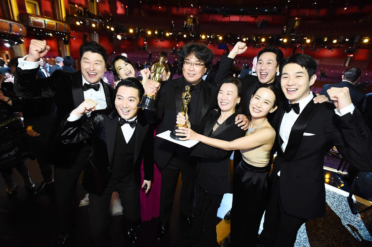 Best Picture Award winners for 'Parasite' pose onstage during the 92nd Annual Academy Awards at the Dolby Theatre on February 09, 2020.
