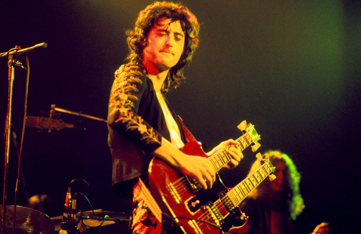 Jimmy Page, playing a Gibson EDS-1275 double-neck guitar, performs live on stage in July 1973