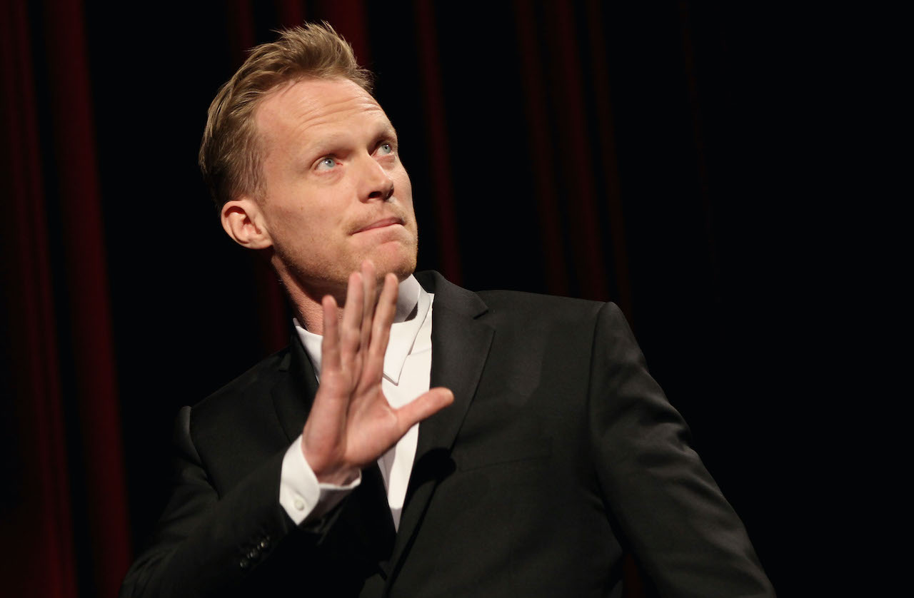 Paul Bettany gestures on stage after the 'Margin Call' Premiere during day two of the 61st Berlin International Film Festival