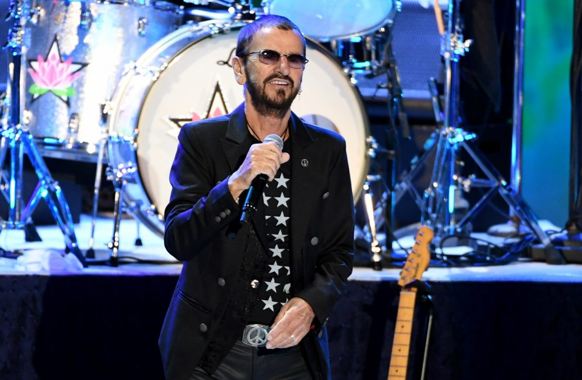 Ringo Starr, with microphone in hand, performs with his All Starr Band at The Greek Theatre on September 01, 2019.