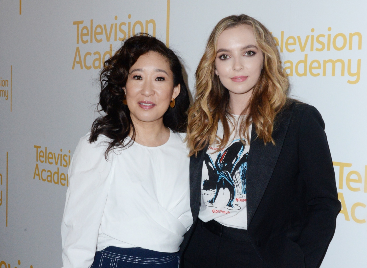 Sandra Oh and Jodie Comer stand together and pose for photographers