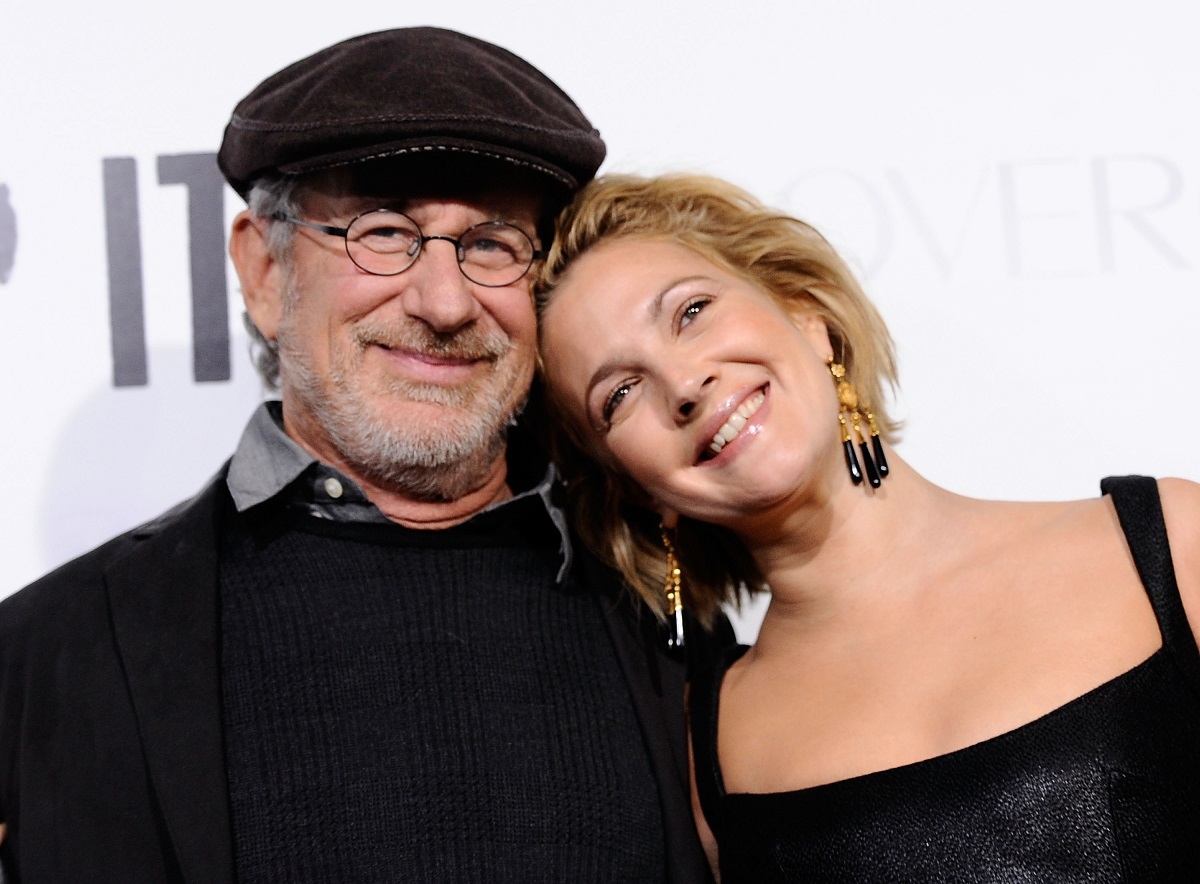 Drew Barrymore (R) leaning her head against Steven Spielberg