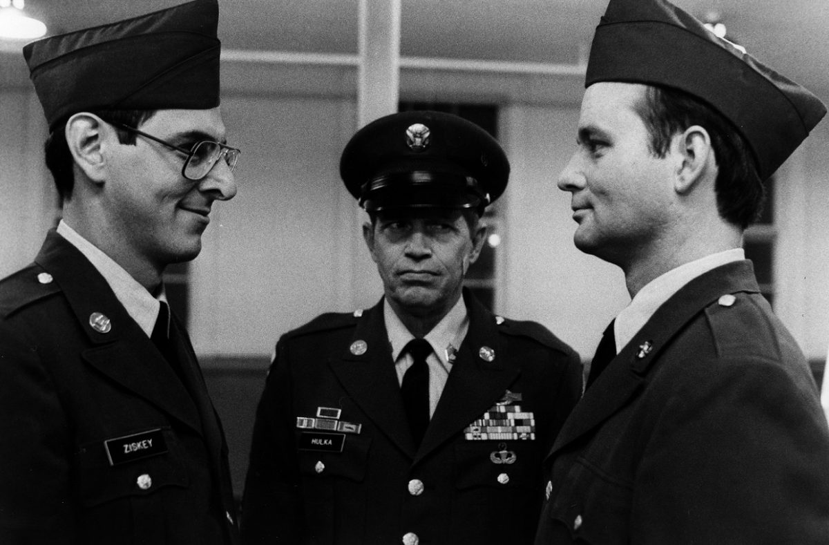 Harold Ramis and Bill Murray smirk at each other in army uniform in 'Stripes'