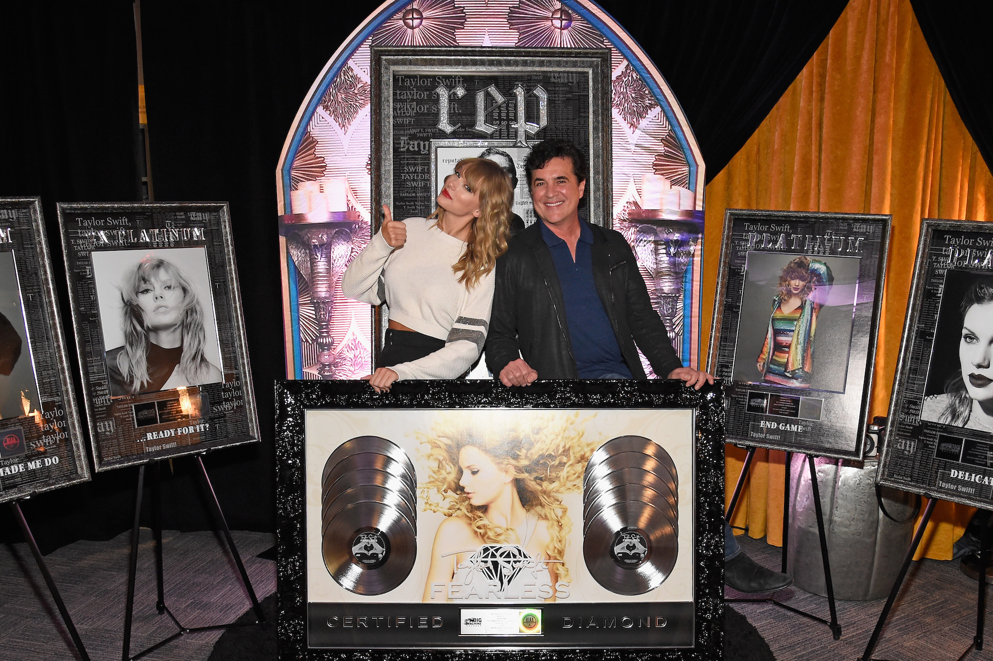 Taylor Swift and CEO of Big Machine Records Scott Borchetta plaque presentation at the Taylor Swift reputation Stadium Tour on July 21, 2018