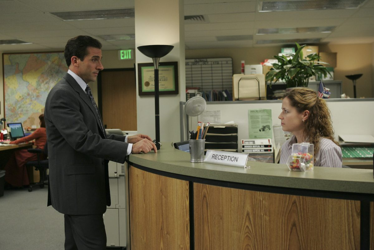 'The Office': Steve Carell stands at the reception desk as Michael Scott with Jenna Fischer as Pam Beesly