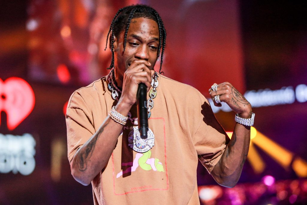 Travis Scott with a microphone