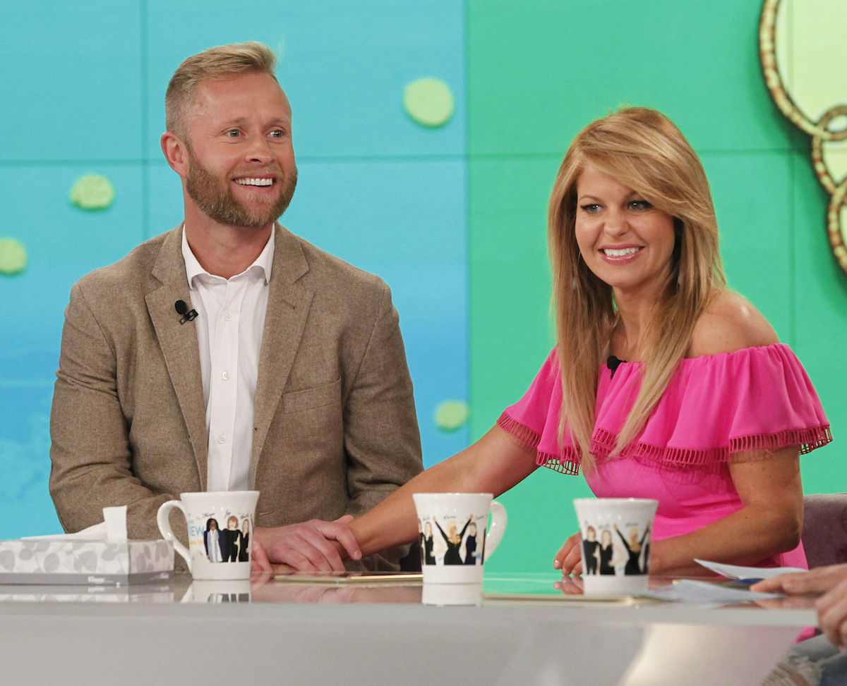 Valeri Bure and Candace Cameron Bure, wearing pink top, on The View in 2016