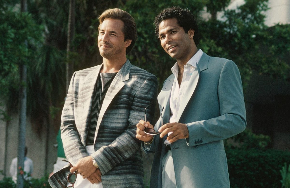 Don Johnson and Philip Michael Thomas smile during a 'Miami Vice' scene