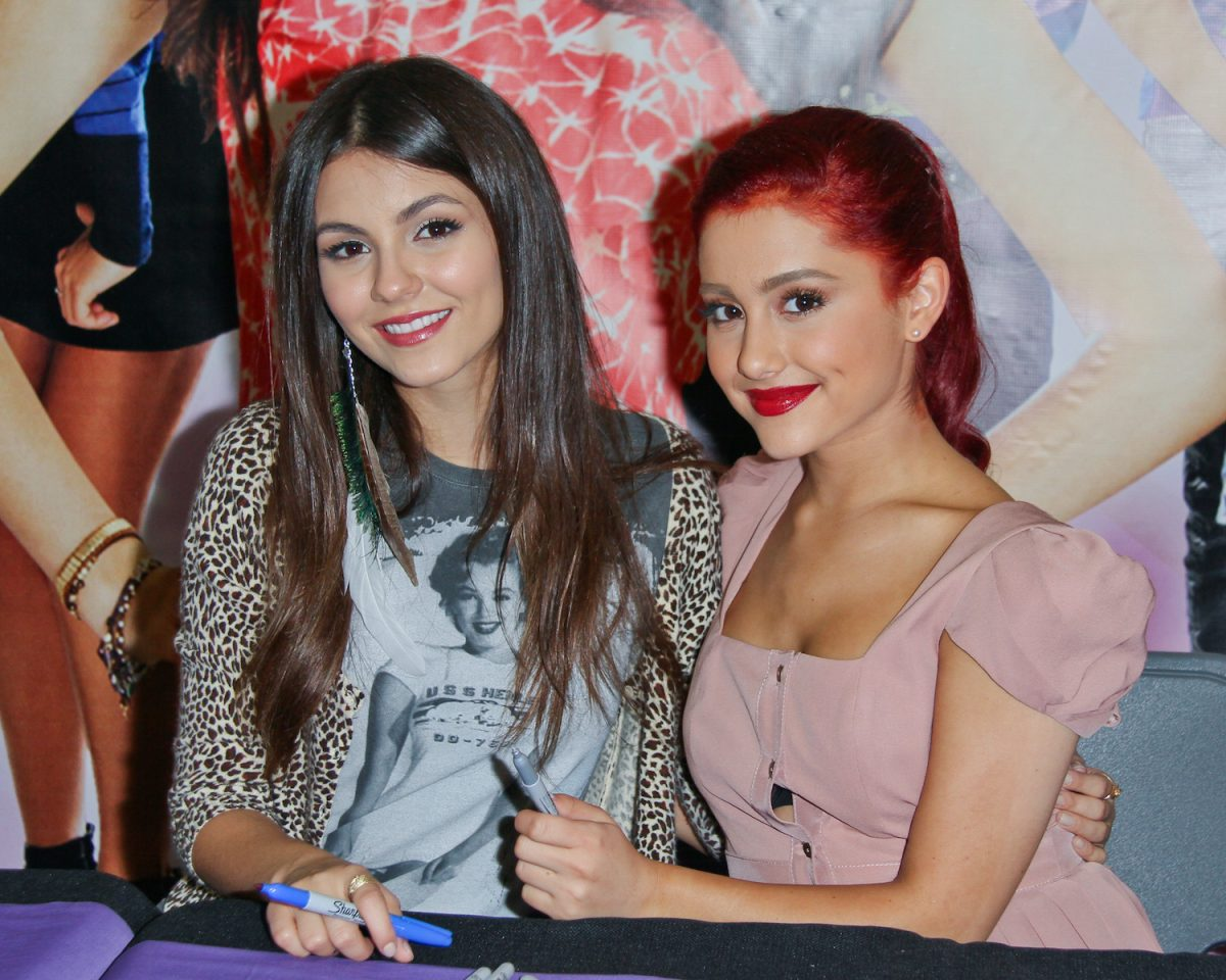Victoria Justice and Ariana Grande attend a CD signing for 'Victorious: Music From The Hit TV Show' in 2011