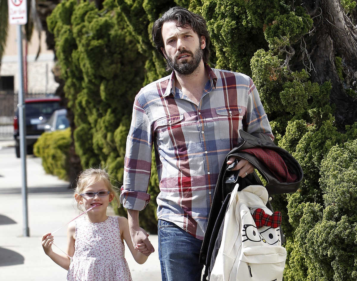 Ben Affleck holding his daughter's hand and walking her down the street