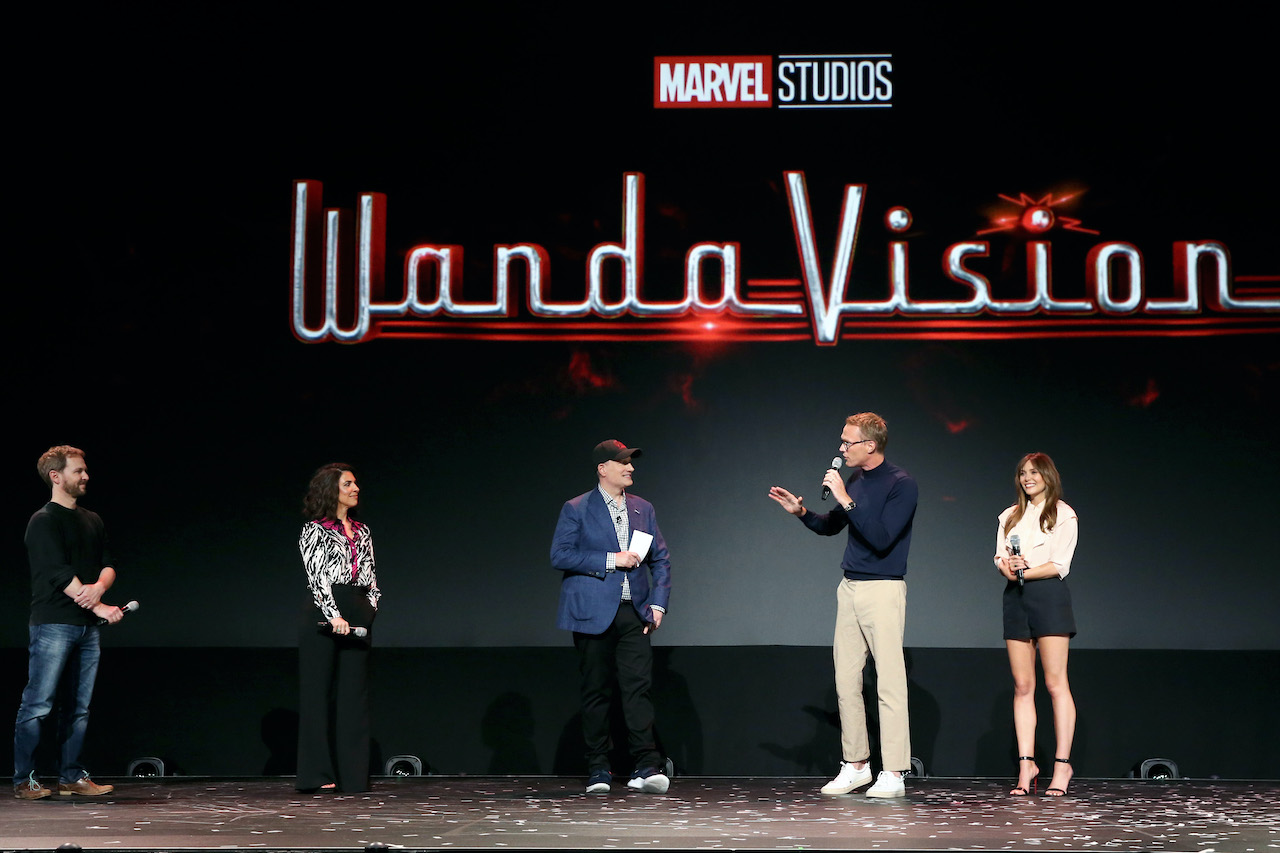 'Wandavision' director Matt Shakman stands on stage with head writer Jac Schaeffer, Marvel Studios President Kevin Feige, Paul Bettany and Elizabeth Olsen at the Disney+ Showcase