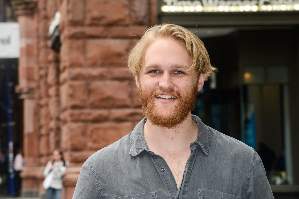 Wyatt Russell smiles at the AOL Build taping in 2017