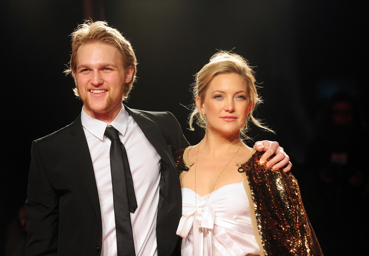 Wyatt Russell with his arm around sister Kate Hudson