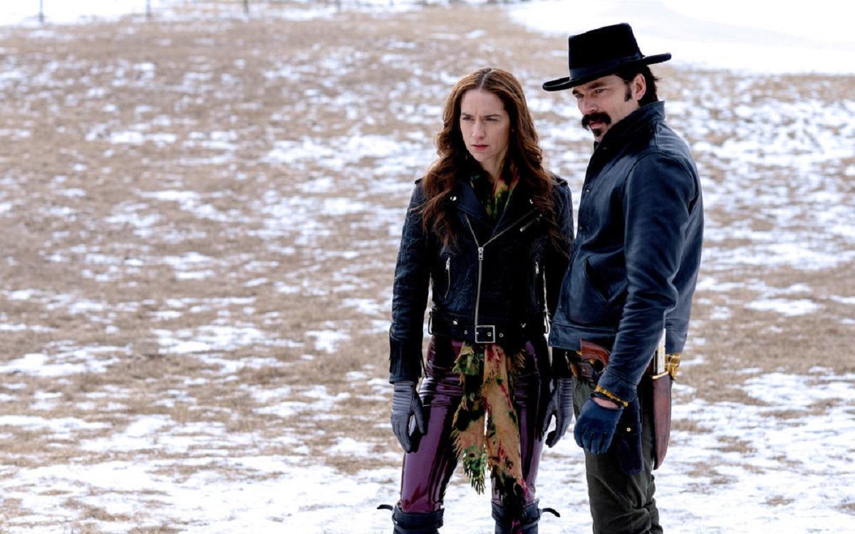 Wynonna Earp and Doc Holliday standing on snowy land in 'Wynonna Earp' Season 4