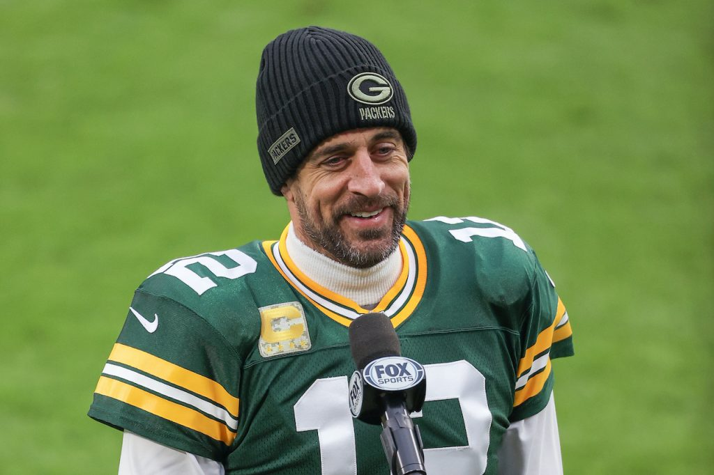 Aaron Rodgers #12 of the Green Bay Packers speaks to the media after beating the Jacksonville Jaguars