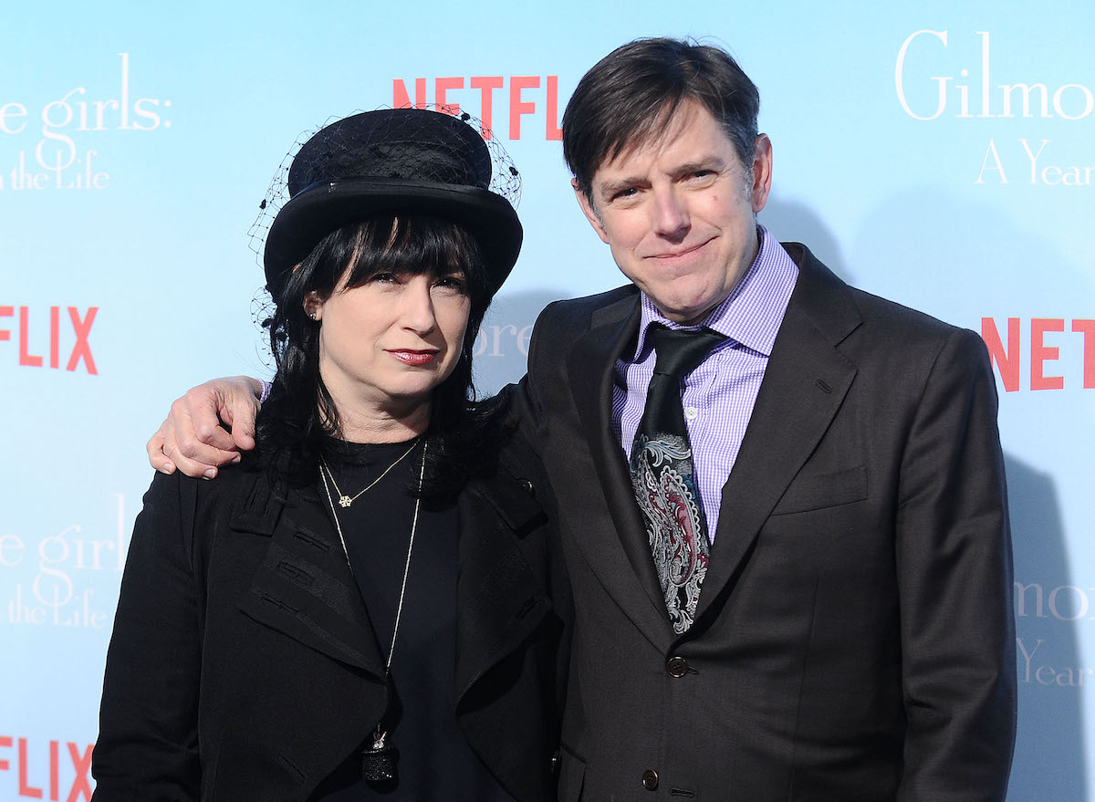 Amy Sherman-Palladino and Daniel Palladino smile for cameras as they arrive at the premiere of 'Gilmore Girls: A Year in the Life'