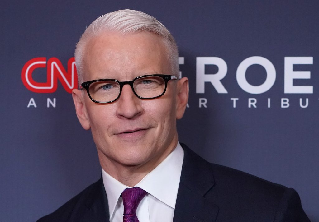 Anderson Cooper smiling for cameras as he attends the 13th Annual CNN Heroes at the American Museum of Natural History