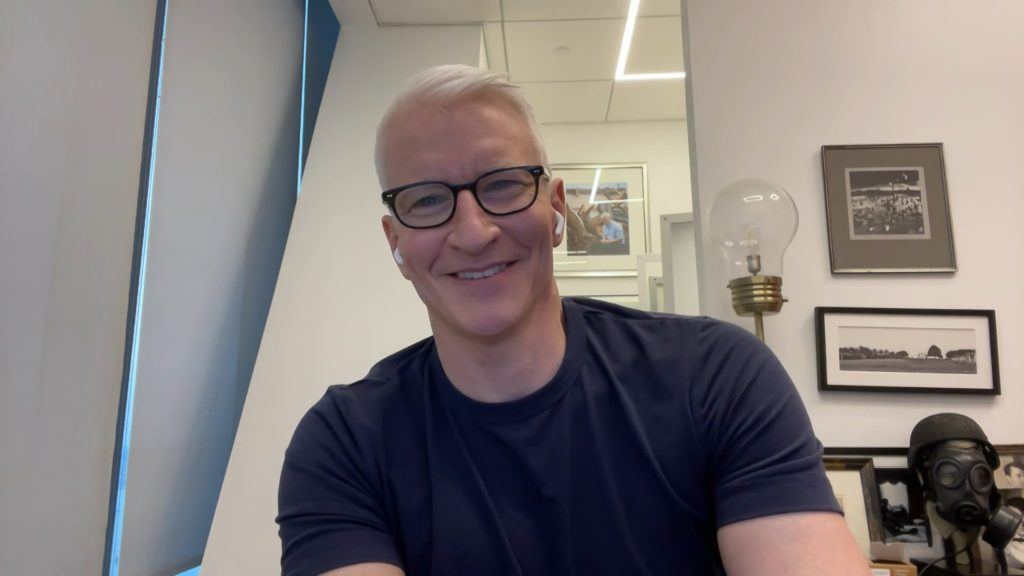 CNN star Anderson Cooper smiling in a black T-shirt