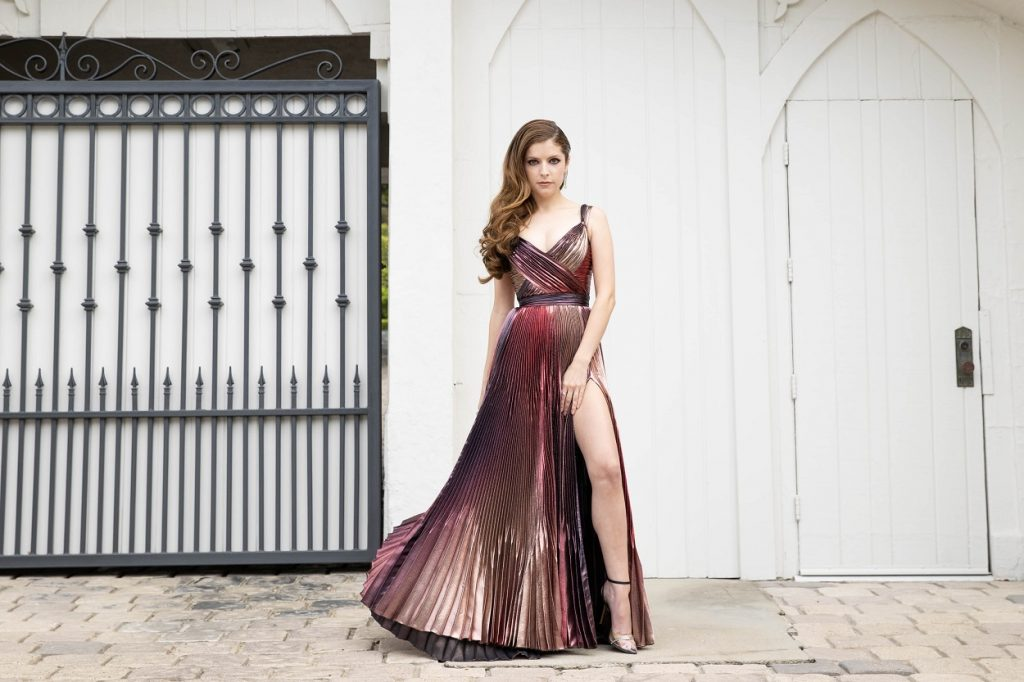 Anna Kendrick star of the Twilight movies poses in a metallic dress and high heels