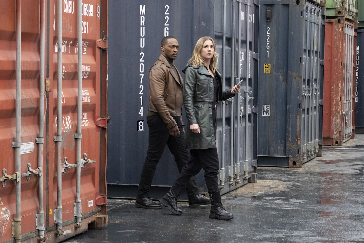 Anthony Mackie and Emily VanCamp walk next to shipping containers on 'The Falcon and the Winter Soldier'