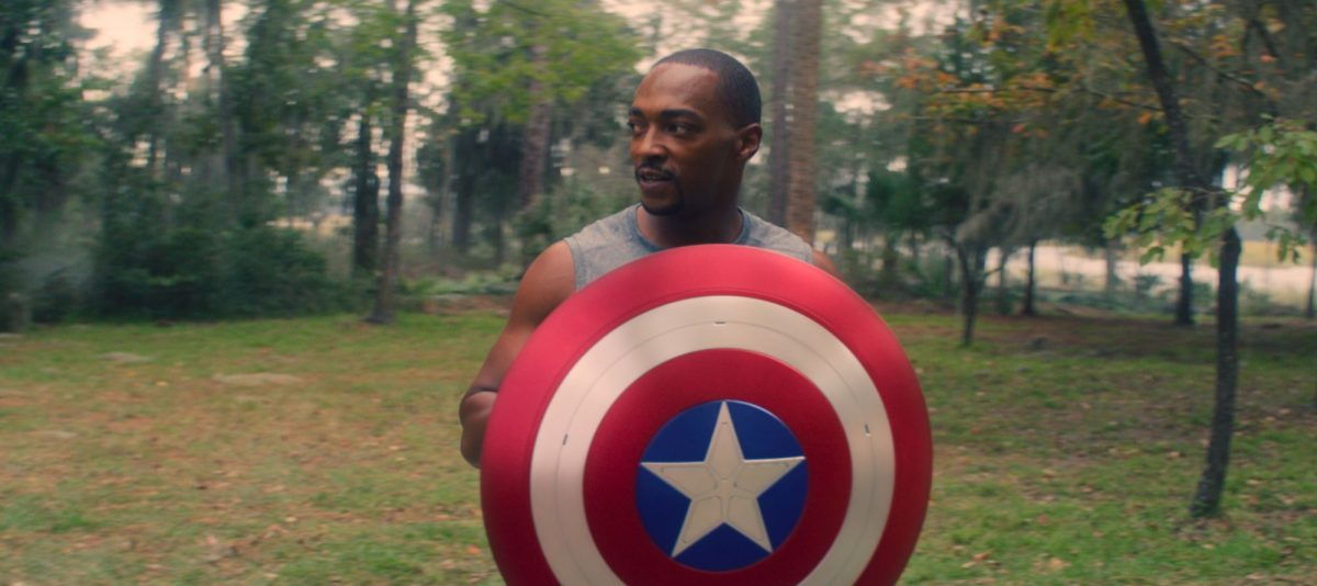 Anthony Mackie holding the Captain America shield in 'The Falcon and the Winter Soldier'