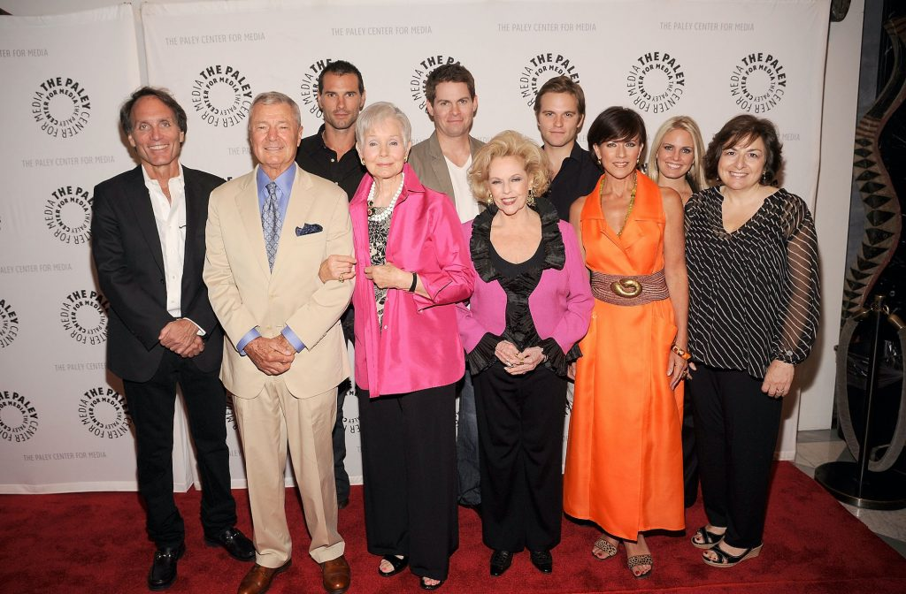 (L-R, 2nd row) Actors Austin Peck, Trent Dawson, Van Hansis, (L-R, front row) executive producer Christopher Goutman, actors Don Hastings, Kathy Hays, Eileen Fulton, Colleen Zenk, Terry Colombino, and writer Jean Passanante smiling