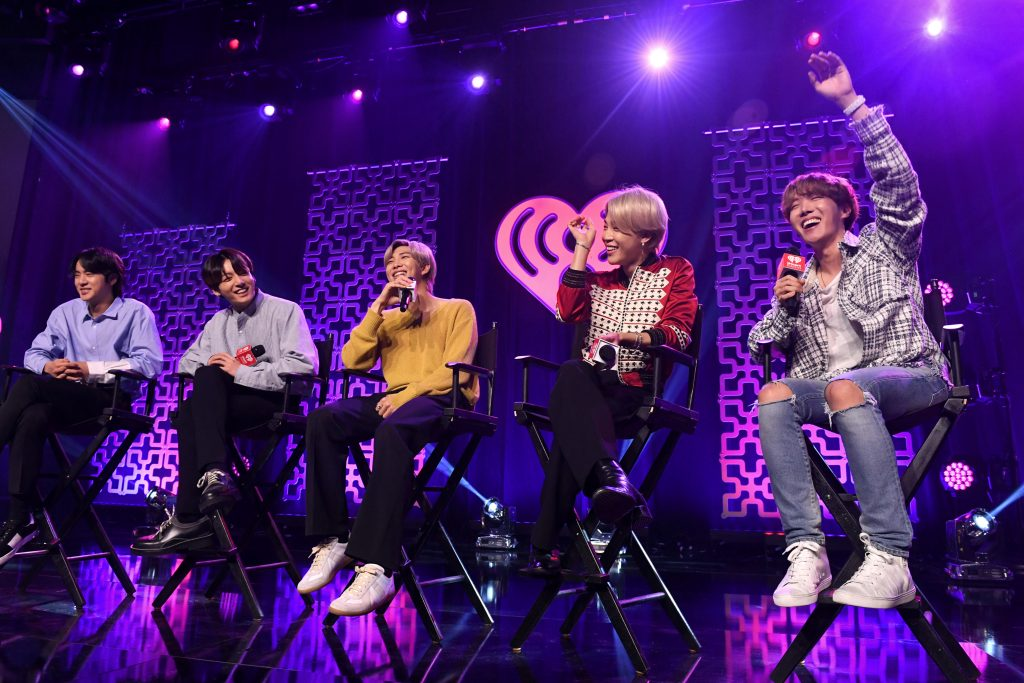 Jin, Jungkook, RM, Jimin, and J-Hope of BTS speak on stage at iHeartRadio LIVE with BTS