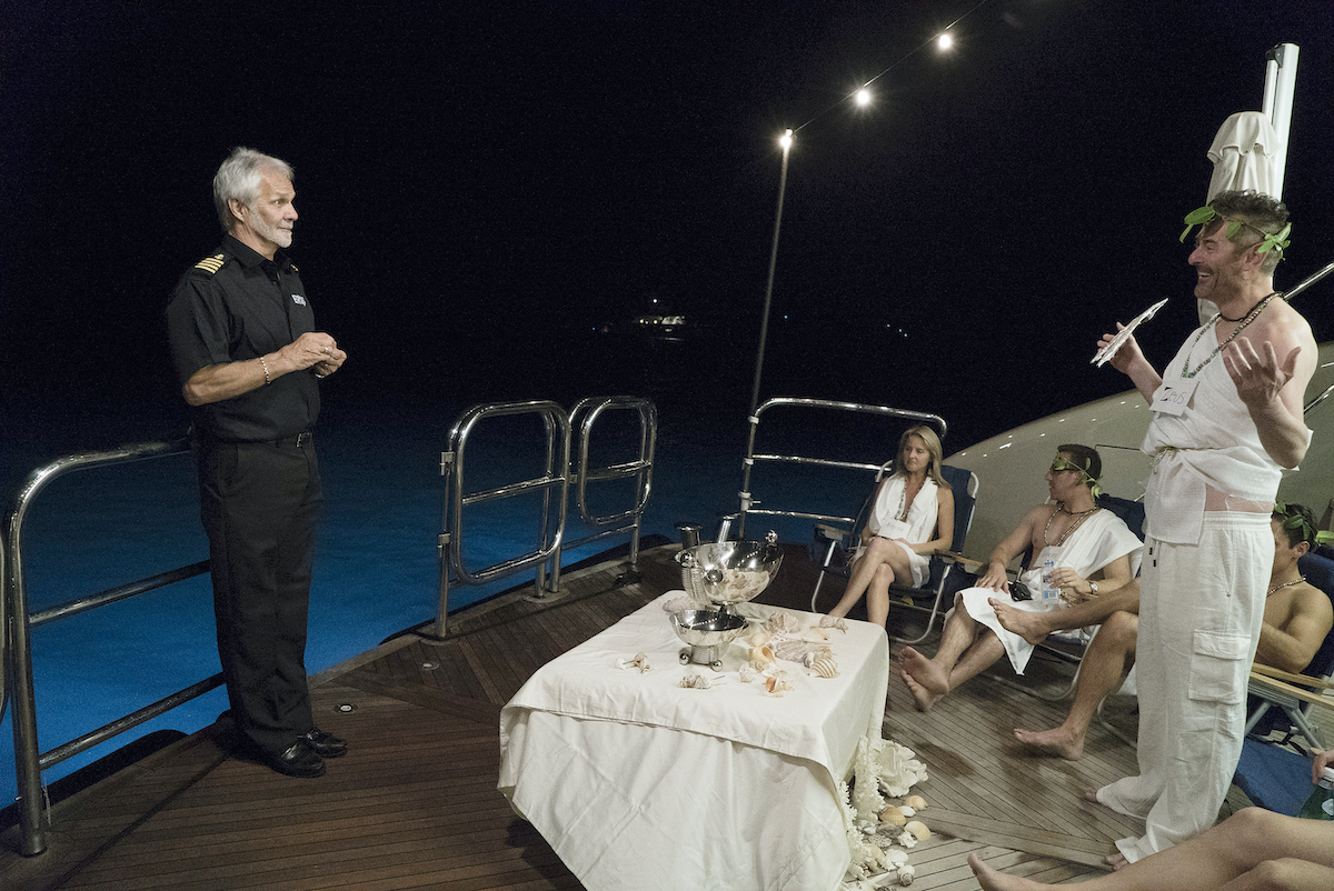 Captain Lee Rosbach chats with Below Deck charter guests