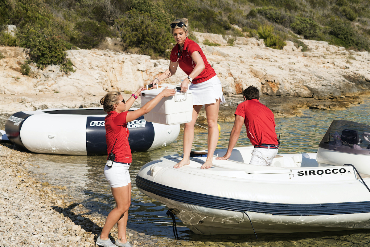 Malia White, Bugsy Drake from Below Deck Med set up for a beach picnic