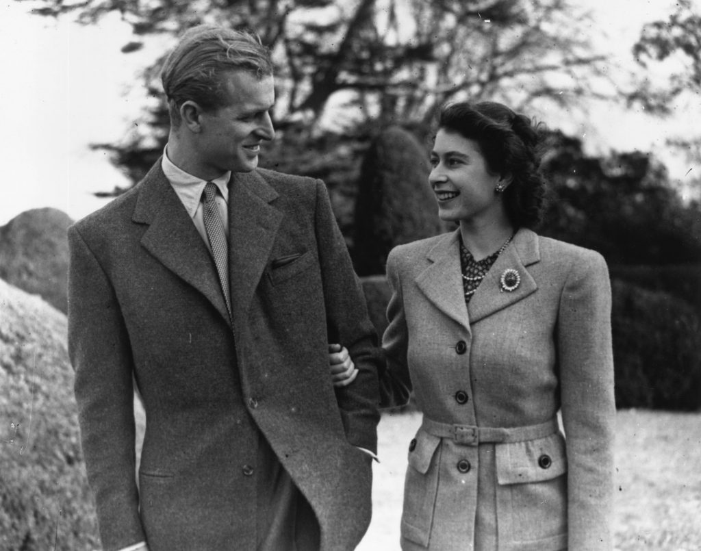 Black-and-white photo of then-Princess Elizabeth and Prince Philip enjoying a walk together during their honeymoon