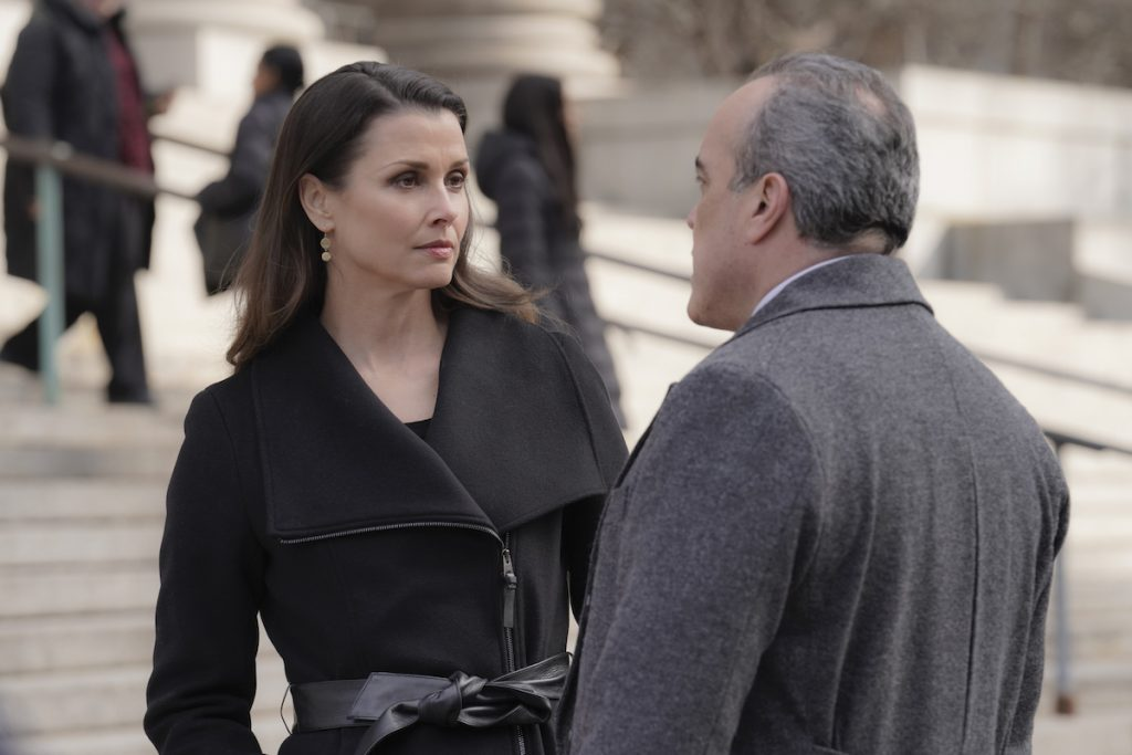 Bridget Moynahan as Erin Reagan and David Zayas as Governor Mendez are talking outside a court building on 'Blue Bloods'
