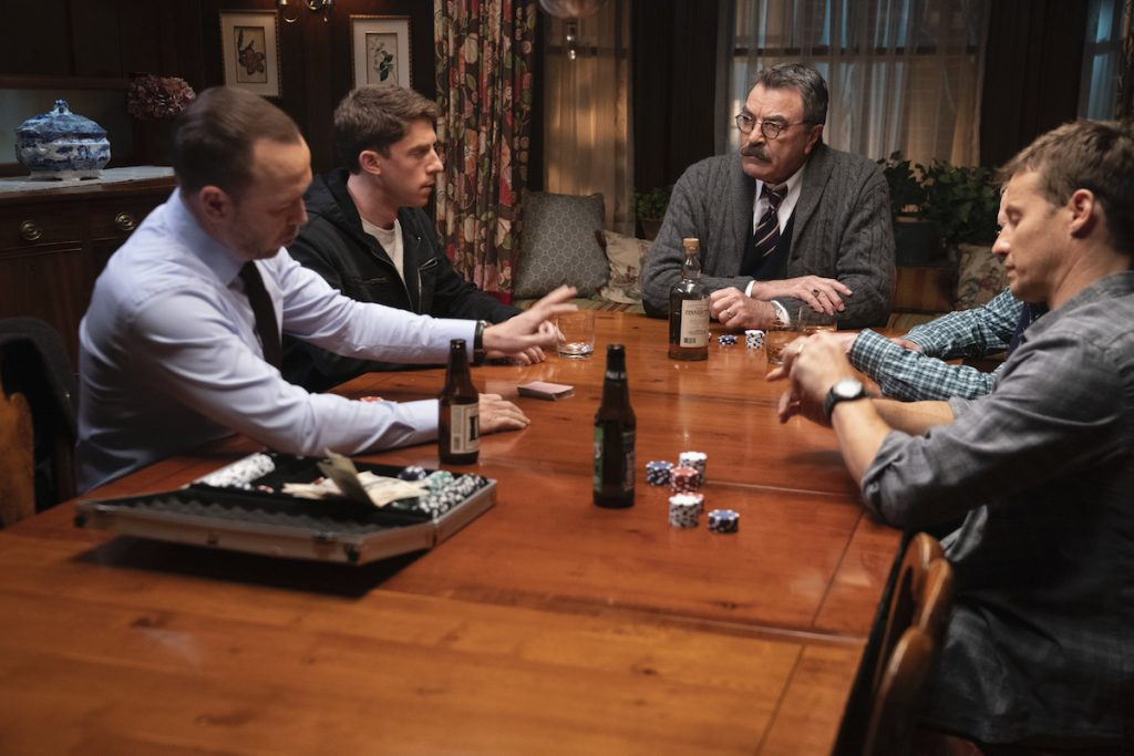 Donnie Wahlberg as Danny Reagan, Will Hochman as Joe Hill, Tom Selleck as Frank Reagan, Len Cariou as Henry Reagan, Will Estes as Jamie Reagan sit at the dinner table playing poker and drinking beer on 'Blue Bloods'