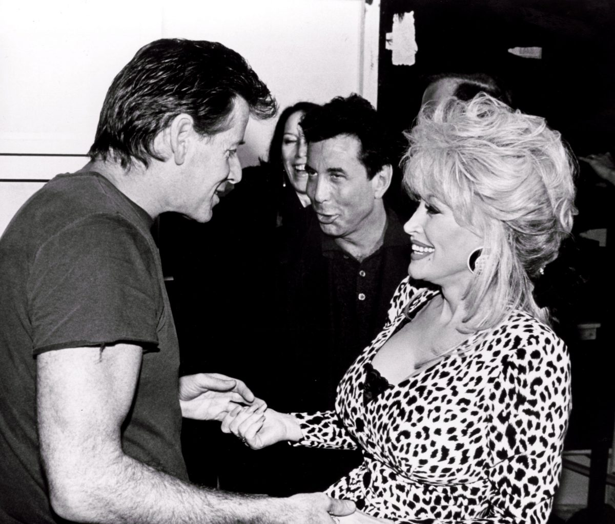 Calvin Klein and Dolly Parton at the 1994 Fall Collections Fashion Show held at Bryant Park in New York City, NY.