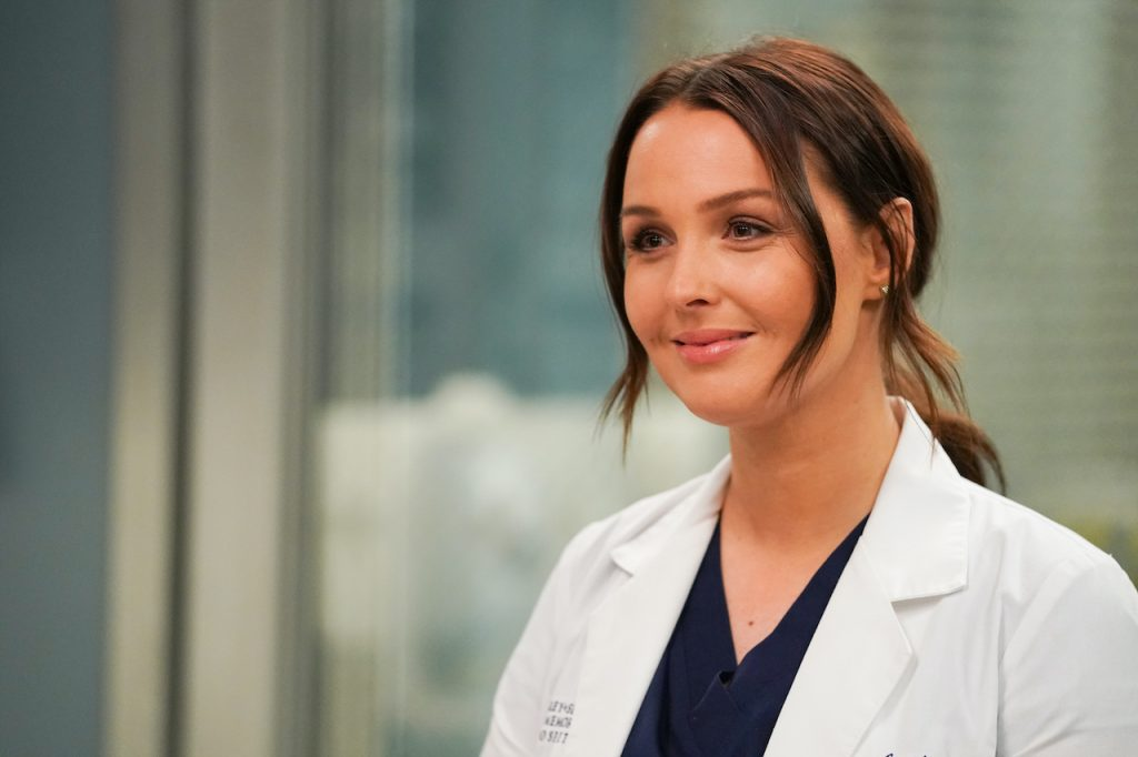 Camilla Luddington smiling and wearing scrubs in a scene from 'Grey's Anatomy'