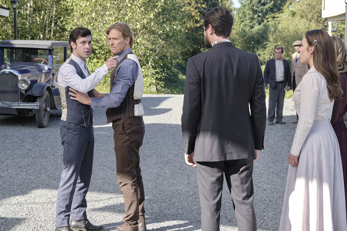 Christopher points at Lucas while Bill holds him back in episode of When Calls the Heart