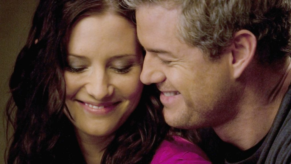 Chyler Leigh as Lexie Grey and Eric Dane as Mark Sloan smiling together in 'Grey's Anatomy'